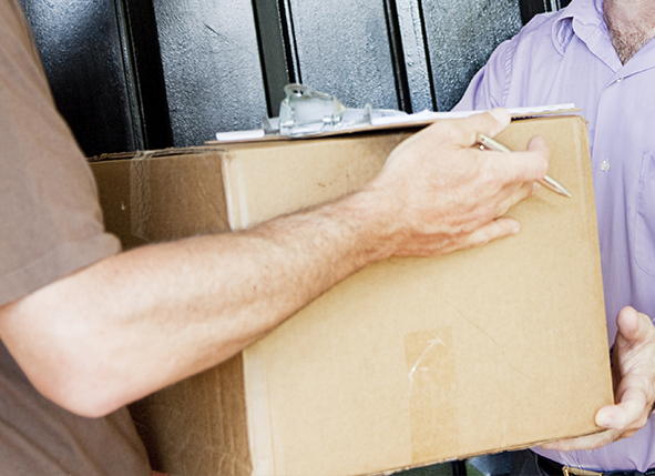 Image of a package being delivered to a customer